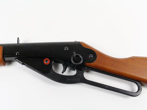 Place the carbine with the saddle ring and leather thong facing upwards.