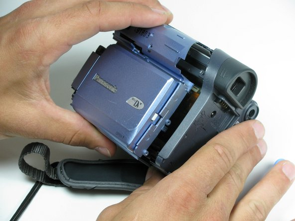 With the blue LCD panel free from the rest of the camcorder, remove the panel from the camcorder.