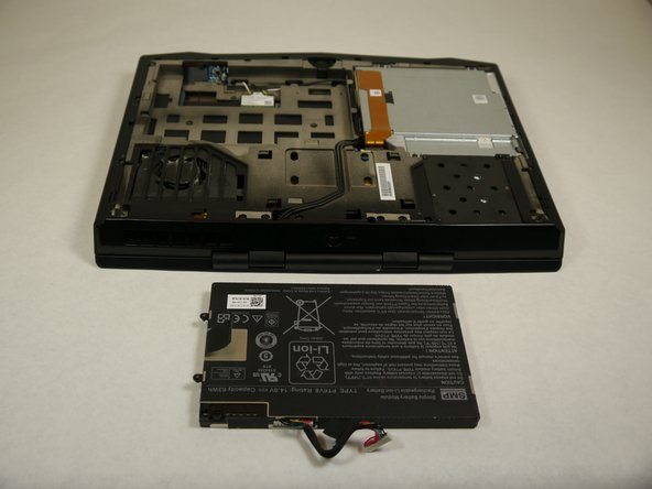 The battery is now free to remove from the laptop and can be set aside.