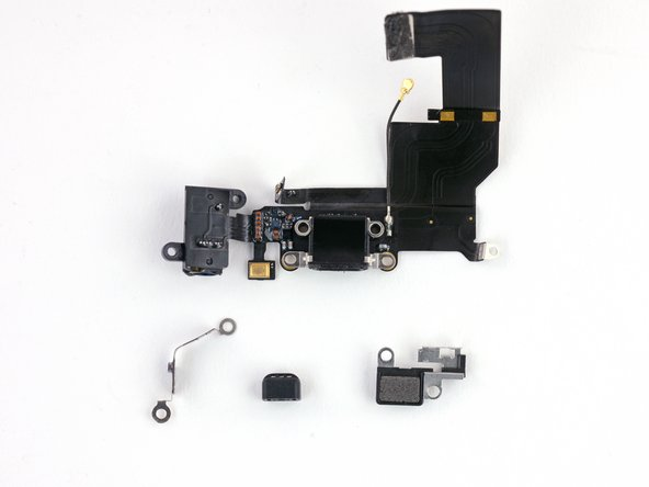 Image 2/2: Components that commonly need to be transferred include a clip routed along the left and top edges of the headphone jack, the rubber microphone cover, and the bracket for the Touch ID cable connector.