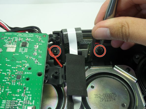 Image 1/1: Remove two 7.0mm Phillips #2 screws.