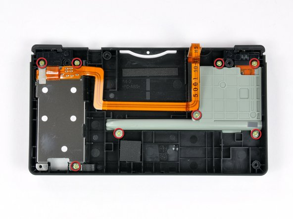 Eight Phillips screws secure the battery compartment and the stylus tray/SD/SDHC expansion slot to the case.