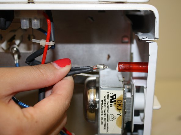 Pull the black wires to remove the indicator light from the red tube.