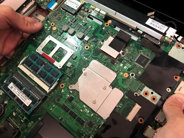 Remove the motherboard from the body of the laptop.