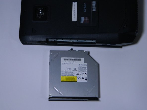 Remove the DVD ROM on the side of the computer, by pulling it out. If necessary, use a plastic opening tool.