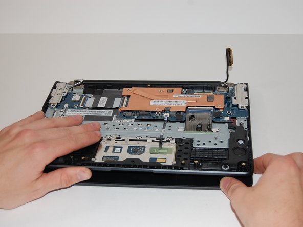 Once the hinge screws have been removed, open the laptop.