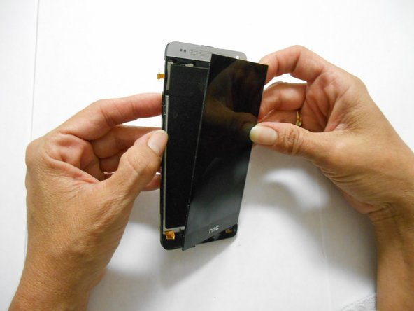 After you have used the opening tool to pry, use some force to separate the LCD screen from the glue.