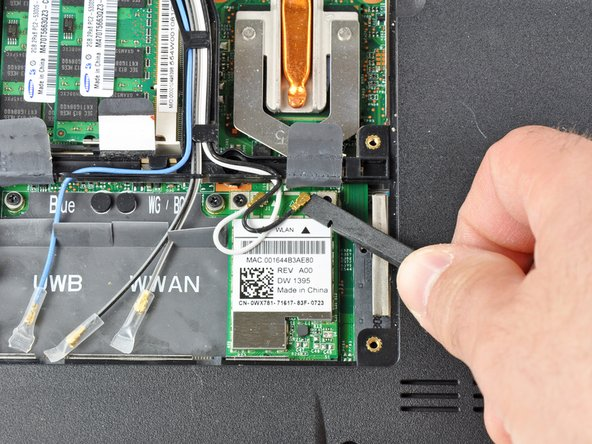 Use the flat end of a spudger to gently pry the black and white antenna connectors off the Wireless Mini-Card.