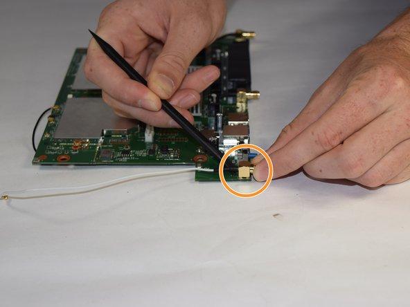 Image 2/2: Remove each port using a nylon spudger