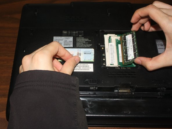 If you want to replace the second RAM module, apply steps 2 and 3 to do so.