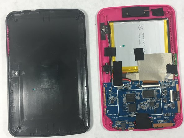 After the screws are removed carefully remove the cover to expose the inside of the tablet.