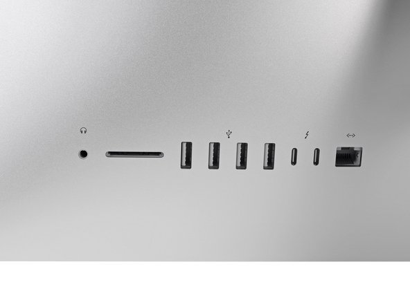 Image 1/2: The ''un''-usual suspects? This iMac's sporting two Thunderbolt 3 ports. These support double the bandwidth of the previous generation—each of these ports can push data at 40 Gbps.