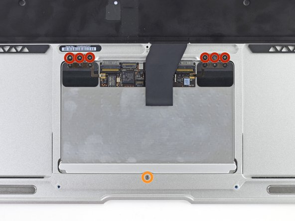 Image 1/1: Six 1.6 mm Phillips screws securing the trackpad to the upper case.