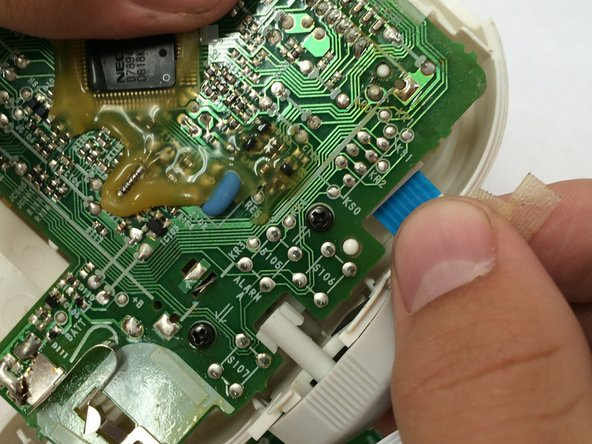 For the product's safety, remove the ribbon cable shown.