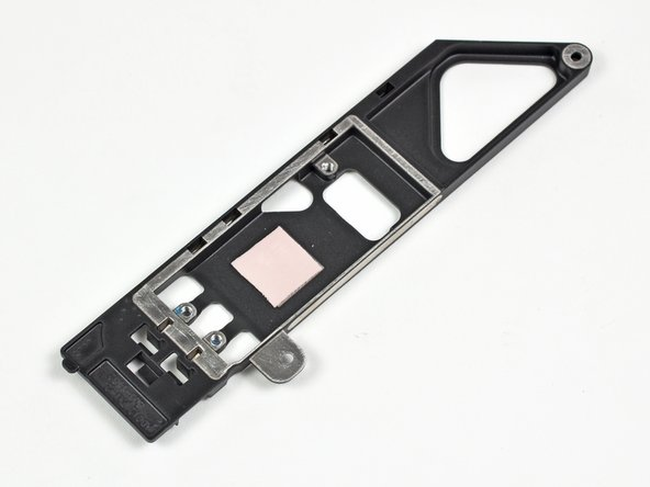 Image 3/3: The wireless card bracket is aluminum, rather than the plastic in previous revisions. Perhaps this change was made for thermal reasons, as a visible pink thermal pad is used to transfer heat from the board to its aluminum bracket.