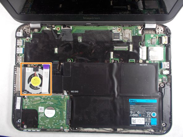 The cooling fan is now visible on the left side of the laptop.