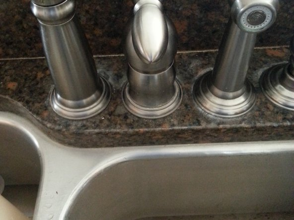Insert ball stem into hole in faucet handle and tighten set screw