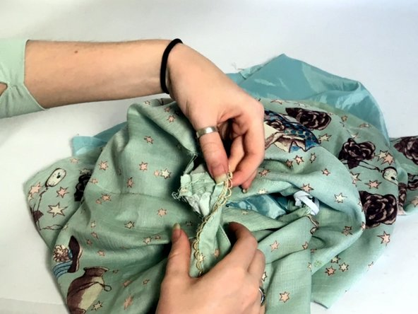 Pinch the waistband together at the side seam.