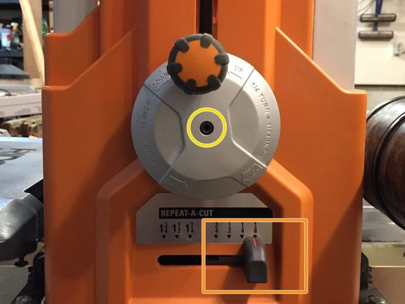"""Remove M5 x 16mm screw with lock washer from center of handwheel using 3mm allen wrench. Pull off """"Repeat-a-Cut"""" knob."""