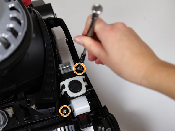 Remove the two 20mm screws using a JIS 1 screwdriver.