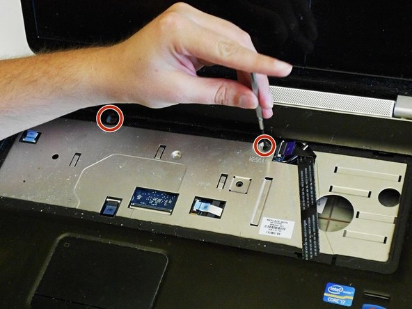 Image 1/1: Note: Both screws under the keyboard are the same size, so they can go to either location in re-assembly.