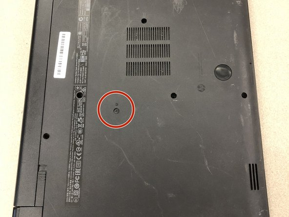 Using a Phillips #1 screwdriver, remove the small screw next to the disc engraving shown in the picture.