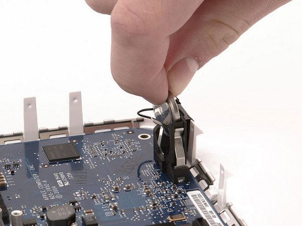 Image 1/1: When inserting the new battery, make sure the side with writing along the edges faces the black plastic holder. You should also insure that the metal connectors make contact with the battery (you can bend them forward if they do not).