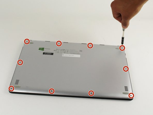 Image 1/1: Remove the ten 3.3 mm screws from the base cover using the T5 Torx screwdriver.