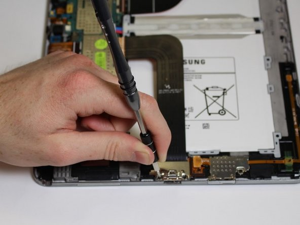 Remove the two 3mm screws  from the silver cover using the Phillips #00 screwdriver.