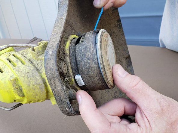 Push the lever to allow yourself to pull 3-4 inches of line out.