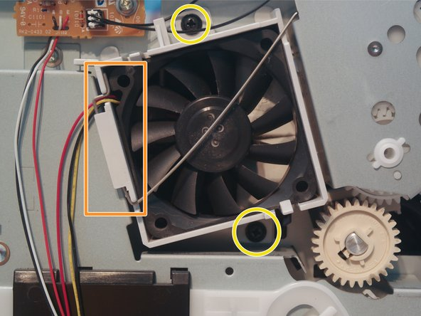 Image 2/2: Remove 2 screws holding in the fan.