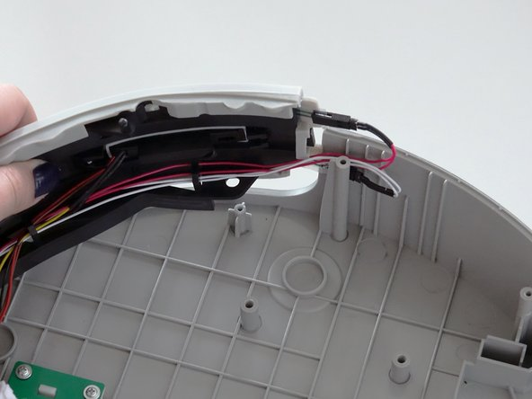 Image 1/3: Once the bumper is positioned on the lid, reinstall the 4 screws around the inside of the bumper.