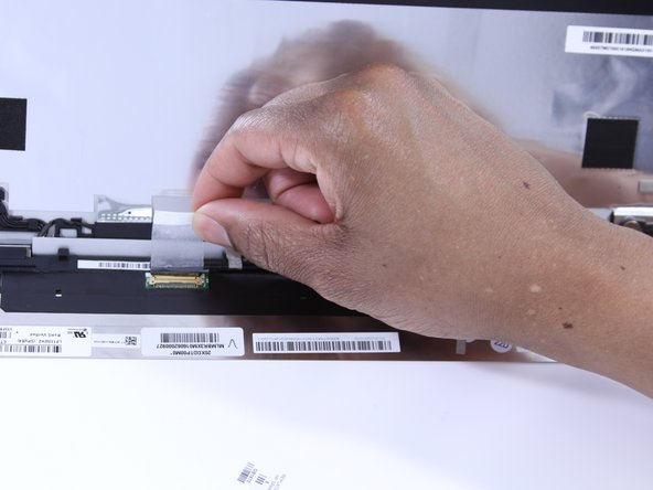 Peel off the adhesive tape and remove the connected cable from the screen.