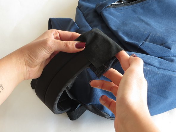 Make sure that the nylon cloth is able to fold over the strap, and align up with the other end.