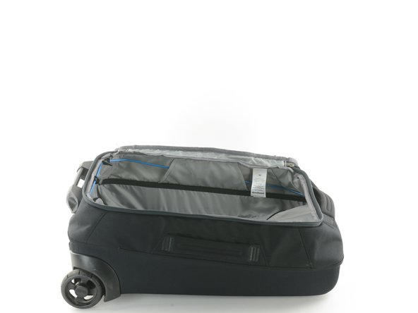 Flip open the main compartment of your bag.
