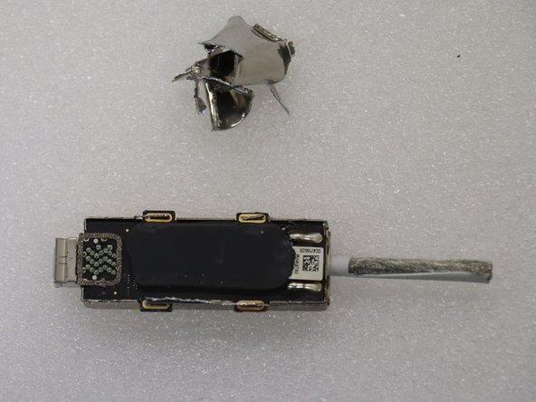 Both sides of the PCB are covered by thermal adhesive.