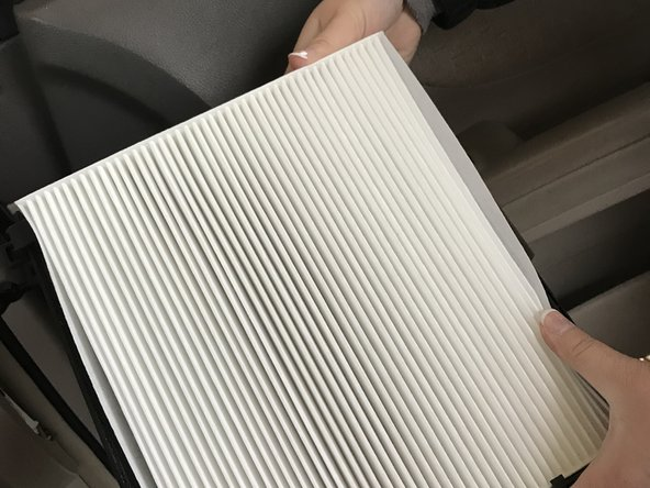 Place the new air filter in the square and push the four corners to lock it into place.
