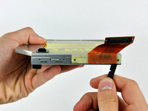 Twist the spudger to separate the connector from the optical drive.