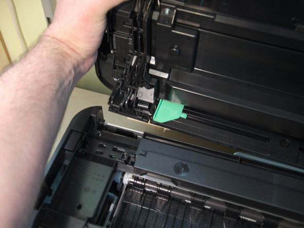 Now you can easily remove the top of the printer by pushing it away from the printer (not up).