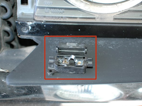 See how the fuse is bent in the middle as it's left-side connection was pulled to the right.