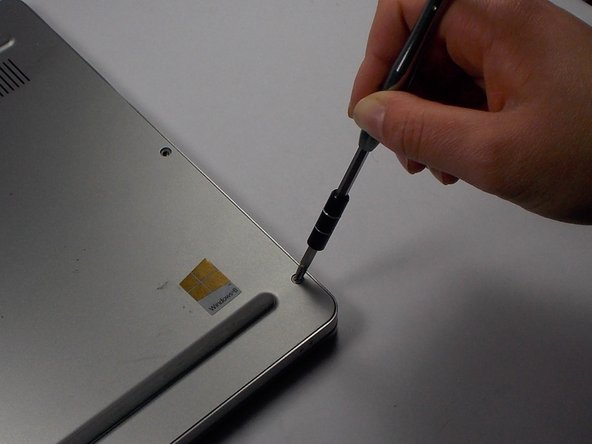 Remove the eight 4.5 mm screws on the back panel of the device using the Phillips 1 Screwdriver.