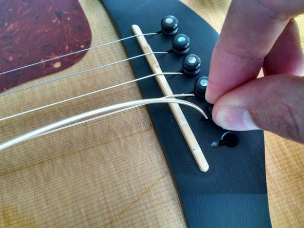 Repeat the procedures in Step 3, starting with the 4th string (D). This time, instead of winding the strings counterclockwise, wind them clockwise so they are all bent in the direction of the center. The final look should be like a waterfall, with all the strings flowing inward toward the center of the neck.