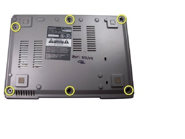 Flip over the PlayStation and remove the six screws from the bottom.
