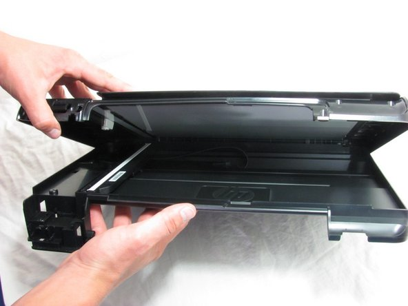 Grip the printer hood and pull upward.