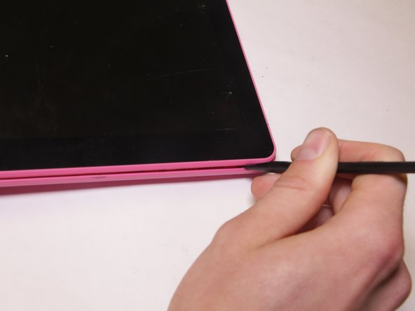 Use a spudger to pry the back cover. Start from one edge of the back cover and slide across until the cover is lifted from the tablet body. Repeat for all edges.