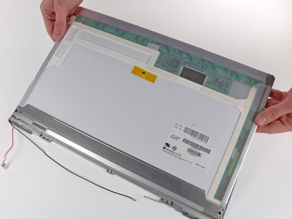 Lift the LCD by its top edge only. Lifting the LCD by its lower edge will damage the backlight cables.