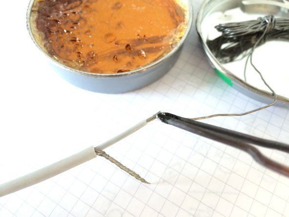 Using a soldering iron/gun, apply solder to all 4 ends of the wires.