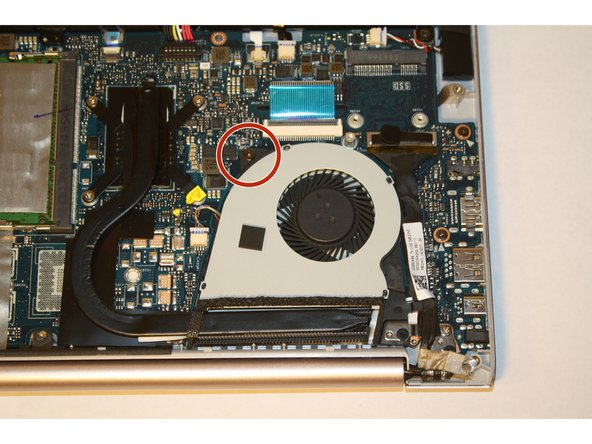 Remove the screw attaching the cooling fan to the motherboard