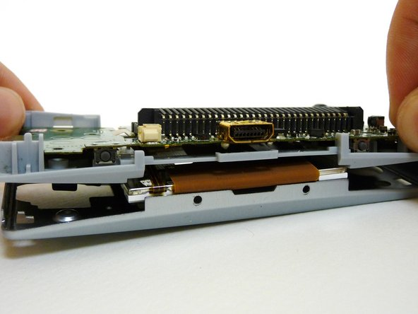 A small ribbon cable connects the start and select buttons to the motherboard. It can rip very easily, so do not pull on it.