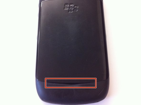 Image 1/2: Pry the rear cover up from the phone.